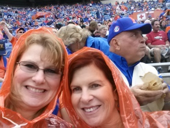 The fun before the storm... Little Orange Riding Hood and her sister Trish with unruly, not overly photogenic or cooperative football fans in the background. Did these people not feel the raindrops splashing around us? This was the weekend before the Nightmare with Coughin' began...